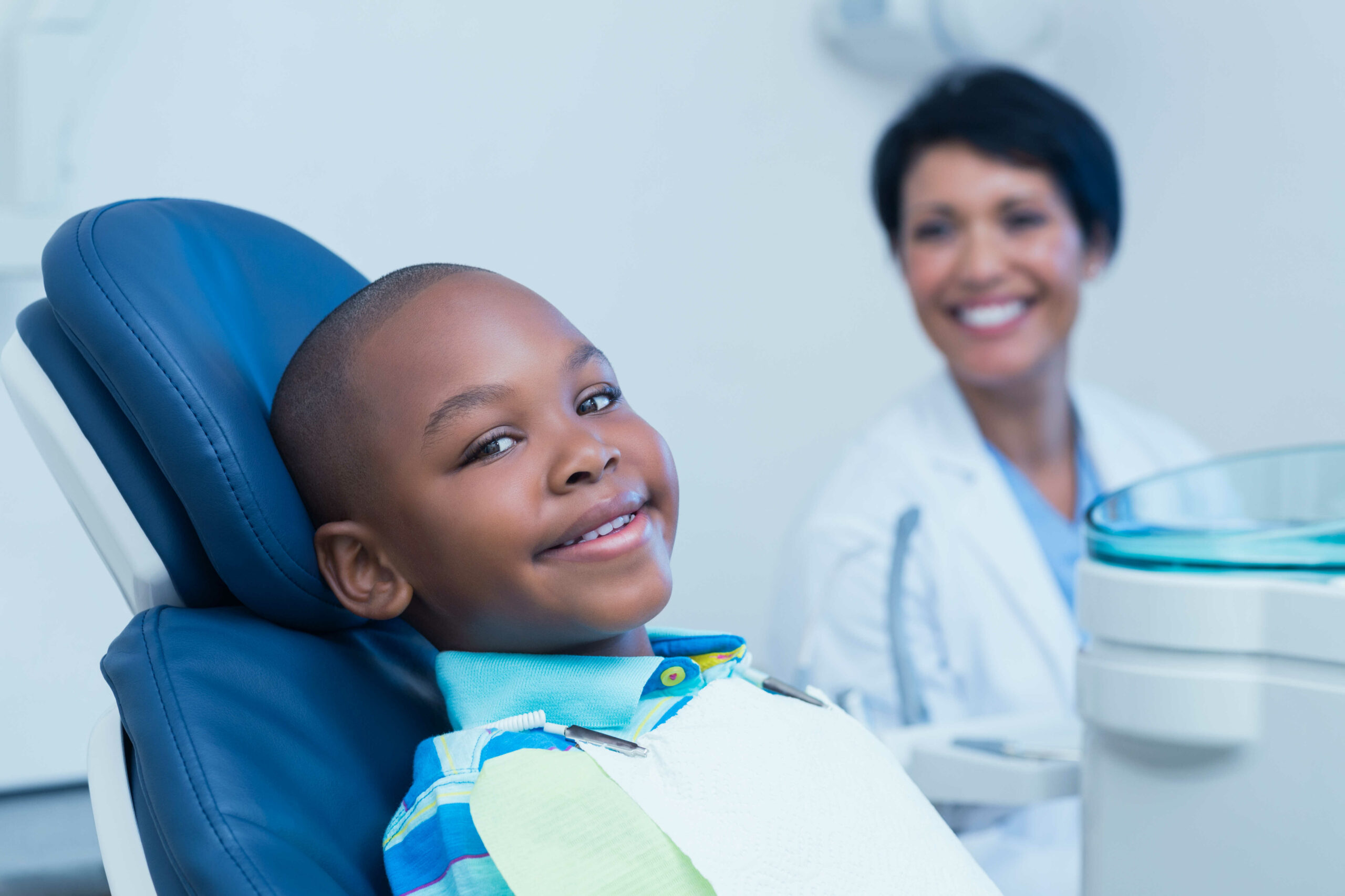 Smiling boy waiting for a dental exam in Chicago