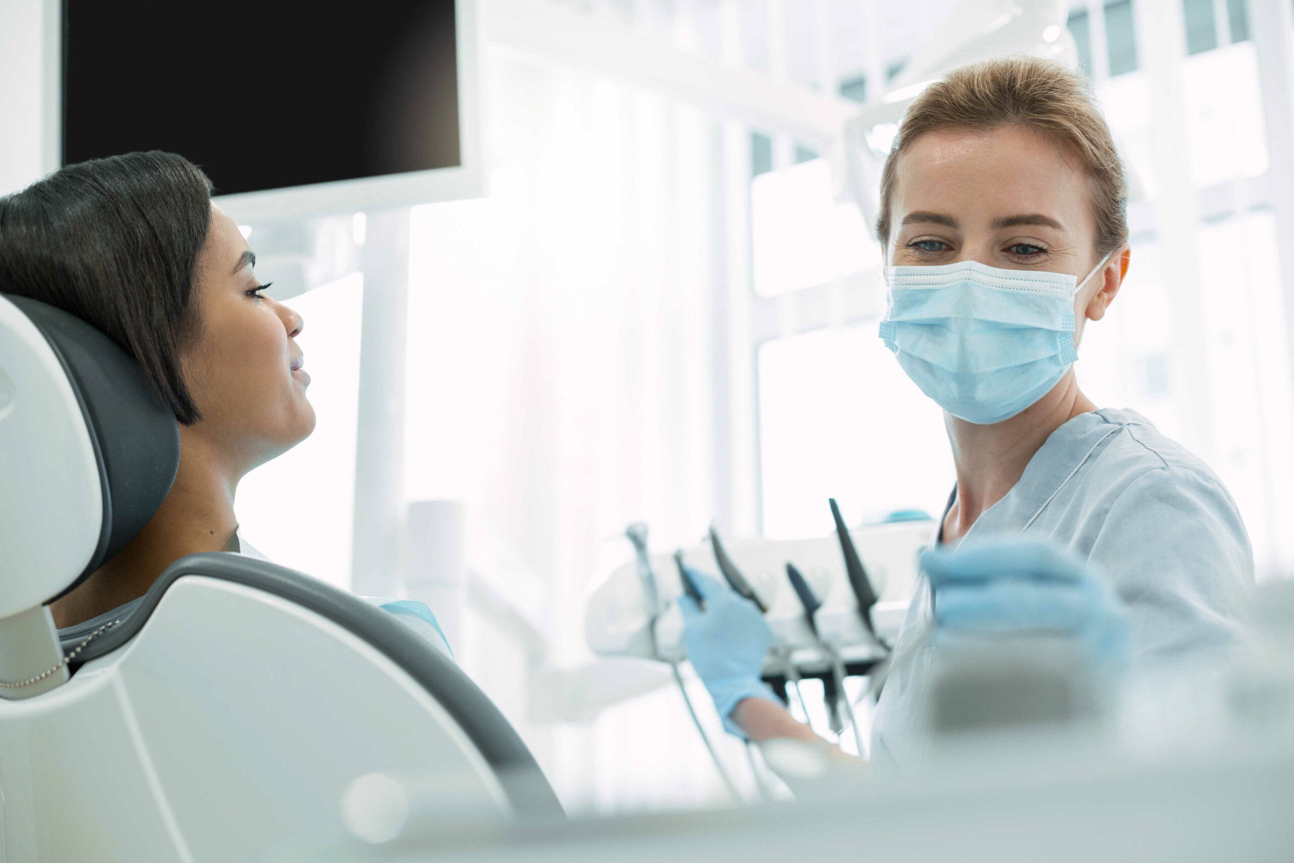 Inspired dentist working with her patient in Chicago